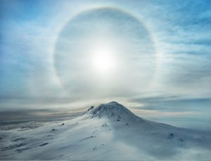 Snow Covered Mount Erebus in Antarctica with a Sunbow